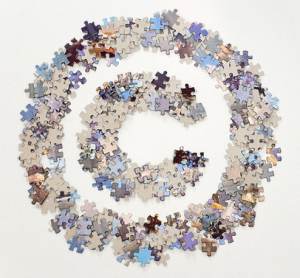 Copyright symbol made of jigsaw puzzle pieces